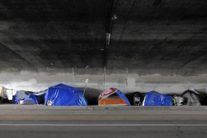 To tackle homelessness, look to jails, hospitals, foster homes, group says