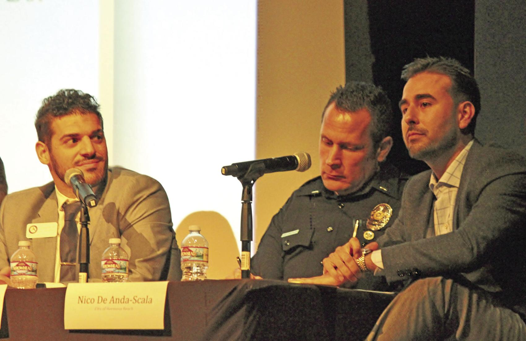"""George Gabriel, senior managment analyst for the city of Manhattan Beach, Lt. Jason Knickerbocker of the Manhattan Beach Police Department and Nico De Anda Scaia, assistant city manager in Hermosa Beach, spoke at the League of Women Voters of the Beach Cities """"Homeless in the South Bay: Issues and Answers"""" presentation Monday at the Hermosa Beach Community Theater."""